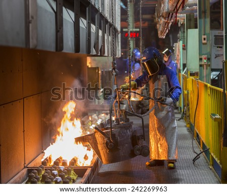 operator pouring automotive part in casting line