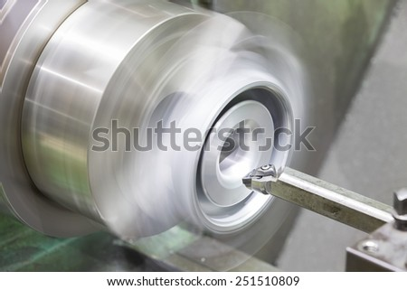 operator turning automotive parts by high precision cnc lathe