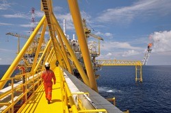 operator walking operation of oil and gas process at oil and rig plant.