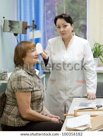 ophthalmologist  and patient testing  eyesight  in clinic