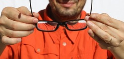 ophthalmologist lets the myopic patient try glasses