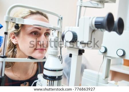 ophthalmology. female doctor checks eyesight at woman