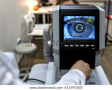 Ophthalmology - ophthalmologist checks the eyes