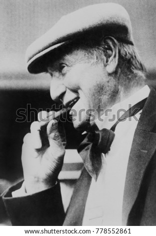 Opie Read, American Southern author, editor, newspaper man and humorist, c. 1920s. He smokes a cigar was on while on a tour of the Northwest with a Galaxy of Golf Stars #778552861