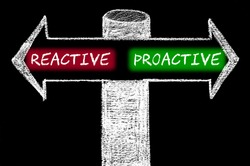 Opposite arrows with Reactive versus Proactive.Hand drawing with chalk on blackboard. Choice conceptual image