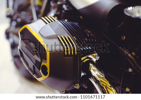 opposite motor of a modern motorcycle close-up. #1101671117
