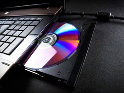 Optical disc drive on a modern laptop computer.