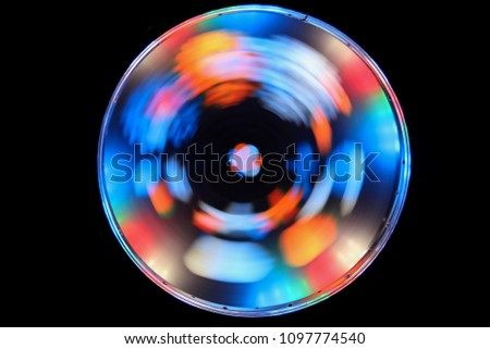 Optical effects. A glowing circle on a black background. Shining round frame with light effect. LED ellipse. #1097774540