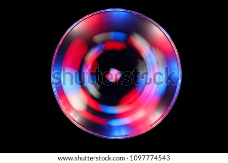 Optical effects. A glowing circle on a black background. Shining round frame with light effect. LED ellipse. #1097774543