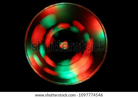 Optical effects. A glowing circle on a black background. Shining round frame with light effect. LED ellipse. #1097774546