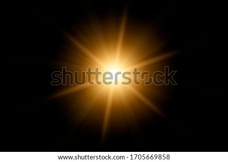 Photo of  Optical lens flare on black background.