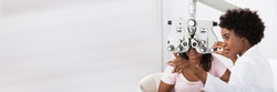 Optician Doing Optometry Eye Exam For Black African Patient