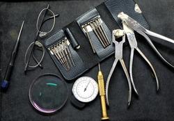 Optician repairing Equipment and fixing eyeglasses, Toolbox Repair Tool. Tooling Parts.