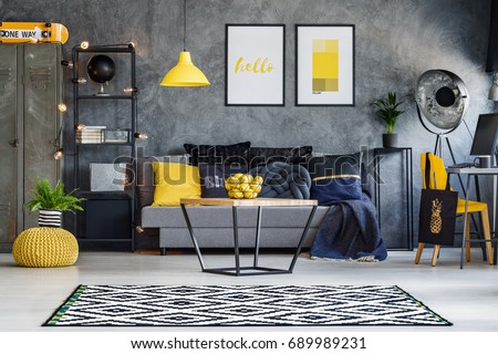 Optimistic teenager's room with gray wall, furniture and yellow accents