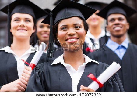 optimistic young university graduates at graduation