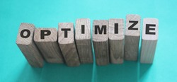 Optimize word on wooden blocks with letters, search engine optimization SEO concept, top view on cyan background.