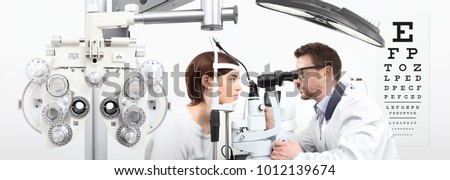 optometrist doing eyesight with woman patient measurement with slit lamp on white background