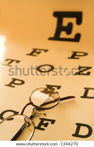 optometrist eye test chart orange - stock photo