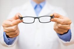 optometrist giving new glasses