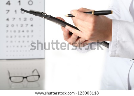Optometrist with notes, examination, isolated white background