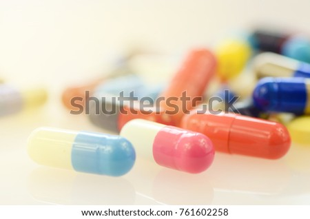 Oral medication background with warm light.Colorful of oral medications on White Background. #761602258