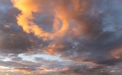 Orange afternoon sun lit on dark blue sunset sky, nature background