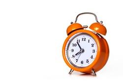 Orange alarm clock, isolated on white