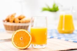 orange and a glass of orange juice, still life
