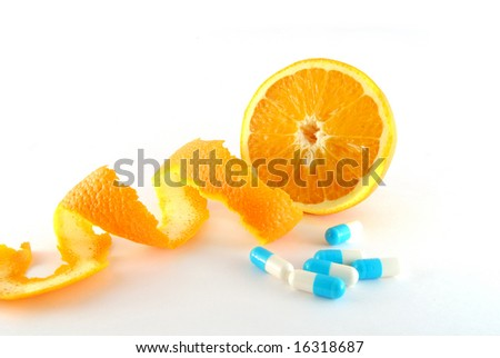 Orange and blue pills on the white background