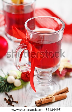 Orange and cranberry punch with spices and Christmas decoration