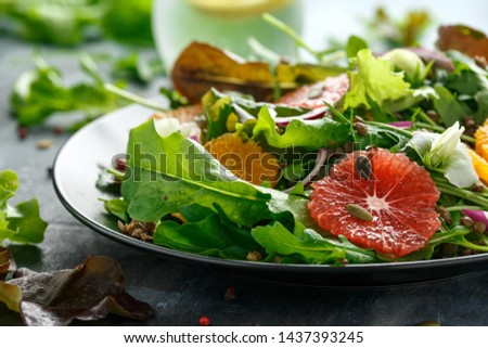 Orange and grapefruit Citrus salad with lentills vertes, wild rocket, arugula, red onion and sprinkle of pumpkin seeds #1437393245