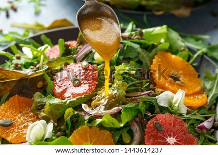 Orange and grapefruit Citrus salad with lentills vertes, wild rocket, arugula, red onion and sprinkle of pumpkin seeds #1443614237