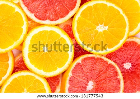 Orange and grapefruit rings as background