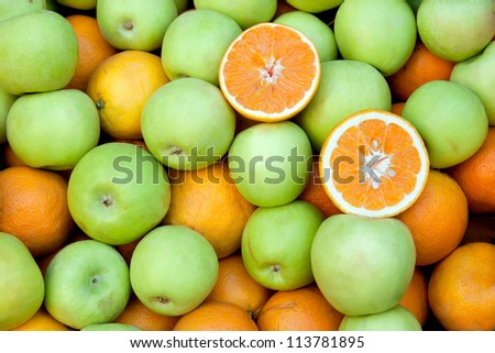 Orange and green apple fruit on market