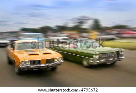 Orange and green color muscle cars cruising on historic woodward avenue.