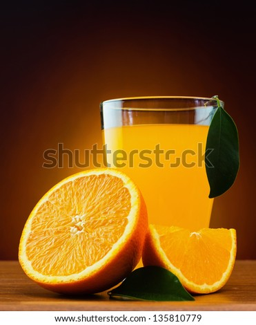 orange and juice on a table