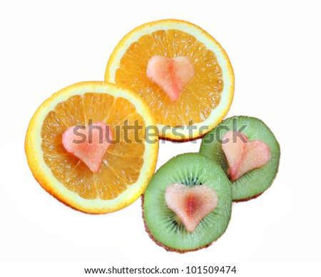 orange and kiwi fruits with heart shapes