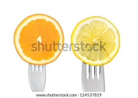 orange and lemon slices on forks isolated against white background