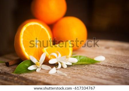 orange and orange blossom on rustic wood background #617334767