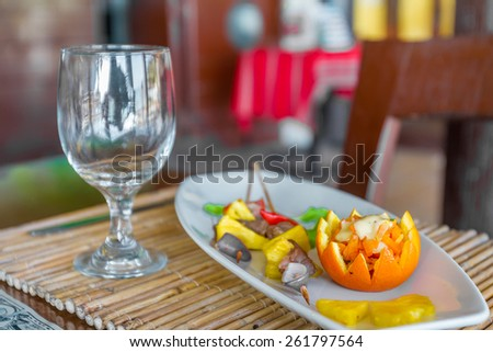 orange and pineapple appetizer served on plate in restaurant or cafe