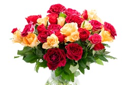 orange and red roses in vase close up