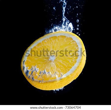 Orange and splash water - stock photo