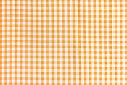 Orange and white abstract checkered pattern background, picnic tablecloth, square fabric texture