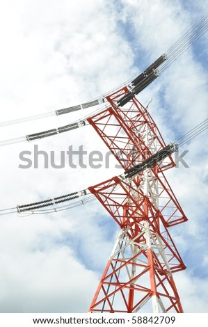 orange and white electric power tower with lines.