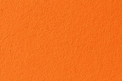 Orange and yellow color concrete wall texture for background and design.