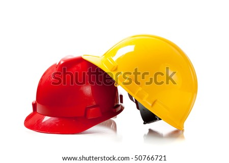 Orange and yellow hardhat on a white background with copy space