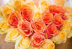 Orange and yellow roses background, romantic bouquet