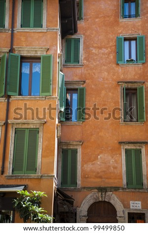 Orange apartment building with green shutters