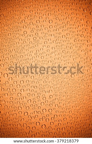 Orange background drops of water on clear glass. #379218379