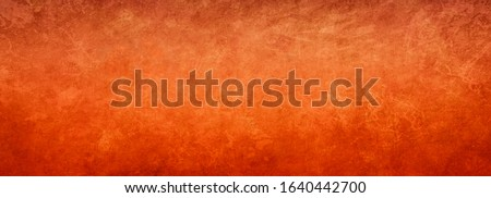 Orange background texture with bright copper color with vintage textured design, elegant fancy rich red orange paper or antique metal rust grunge in luxury template, autumn or halloween background stock photo